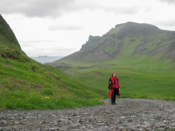 Hiking towards the cliffs that overlook the city of Vik
