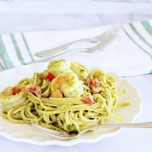 Fettuccine and Shrimp with Arugula Pesto Cream Sauce. Does that sound like date night restaurant food, or what?! Here's the thing - it's so ridicuously easy, you can whip up this dinner in about 30 minutes, and no one has to know.