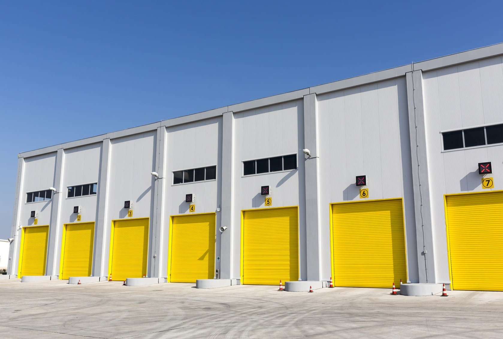 Bright yellow high speed garage doors set into a warehouse for a distribution center. & High Speed Doors u2013 Crawford Doors pezcame.com