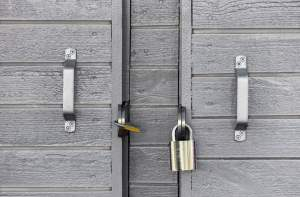 Garage door padlocks