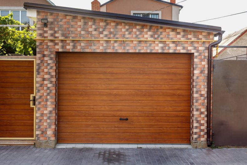 comparing wood faux garage doors