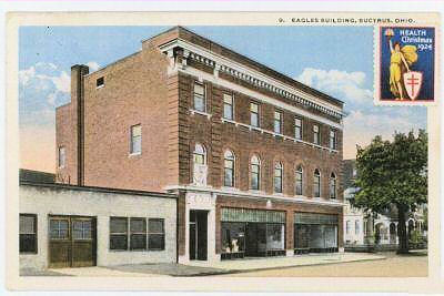 This 1924 view of the Bucyrus Eagles Building was located where and what was in the shorter white building next to it?