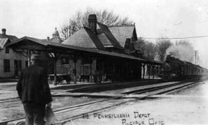 Photo identified as view of Pennsylvania Depot with passenger and train
