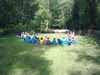 Beavers sitting circle campsite