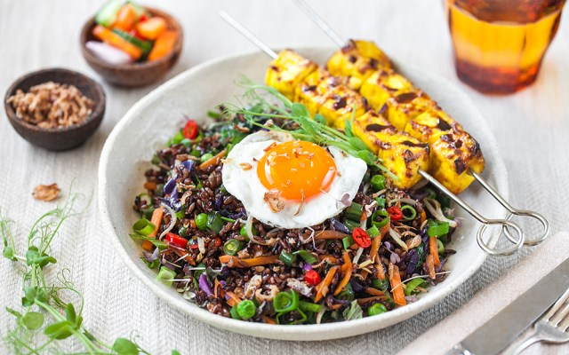 Indonesian-style Fried Rice Nasi Goreng with Egg, Turmeric Tofu Skewers, and Quick Pickles. Vegetarian recipe