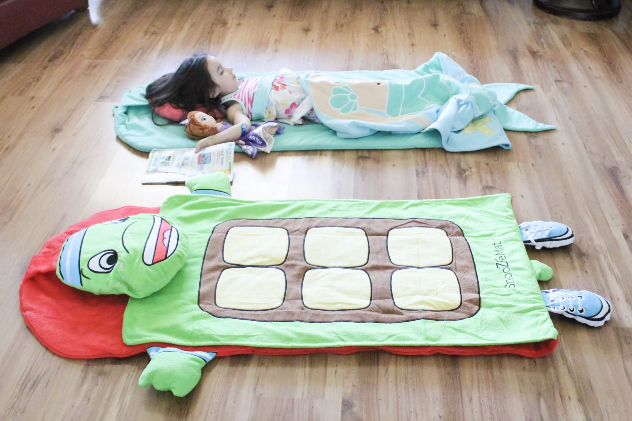 Sleeping Baby SnooZieMat perfect for daycare naptime, sleepovers, and lounging around the house.