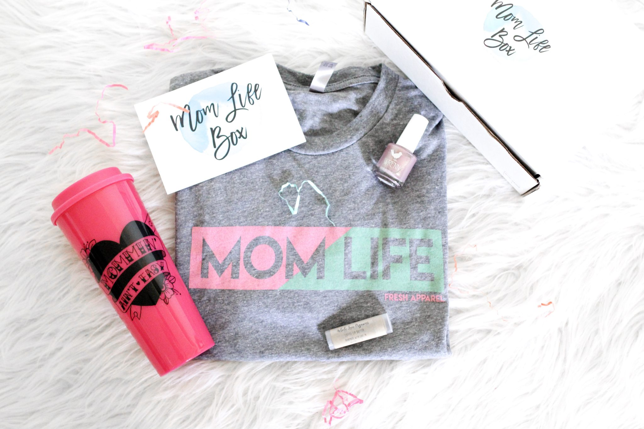 Mom Life Box by Fresh Apparel. $36/month for a box of small shop goodies delivered straight to your doorstep. This box contains one limited/exclusive tee plus 1-3 other small shop goodies hand picked by the owner. Subscription boxes for moms, mom life, mom tees, organic lip balm, 5 free nail polish, Shop Wrenn, Whole Organic Love, Fresh Apparel Tees, Little Hooligans