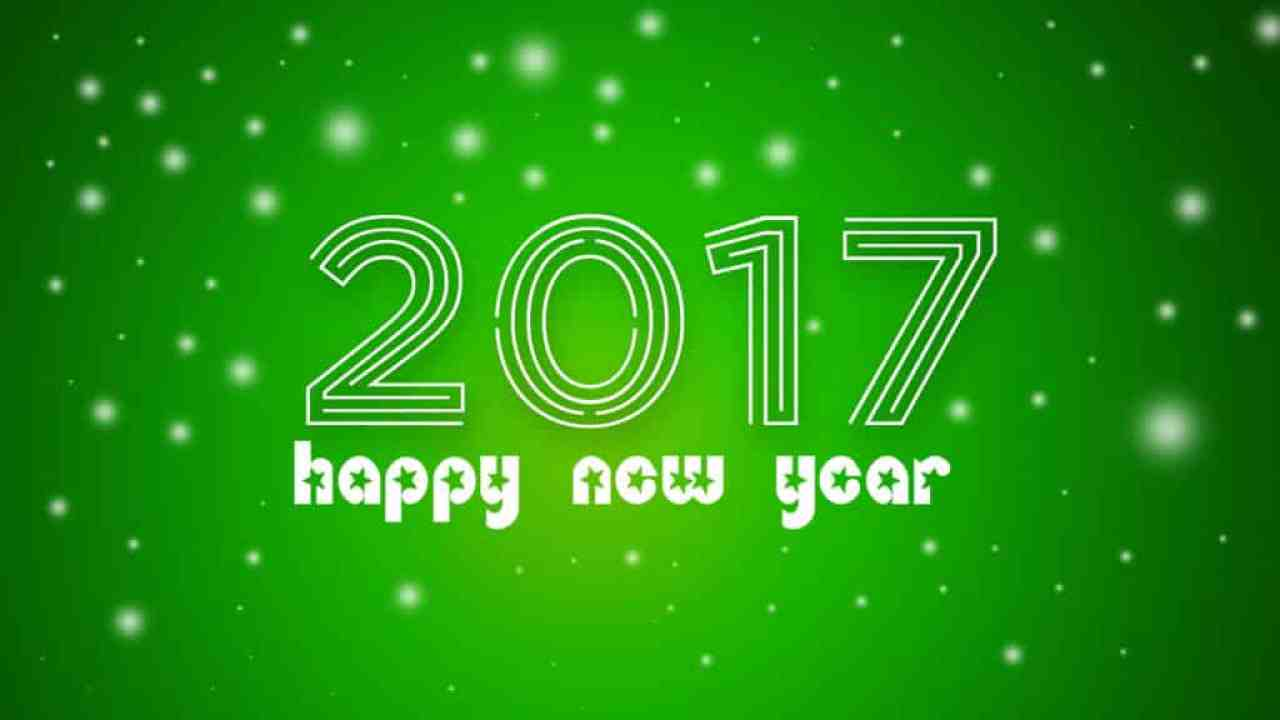Happy New Year 2017 with green background and snowfall