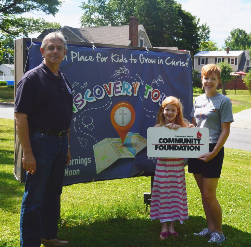 Showing the way to Discovery Town are Family Ministries Pastor, Jeff Johnson; Emery Watkins, and her mother, Leah Johnson Watkins.