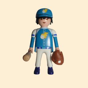 Joueur de baseball avec gant et batte