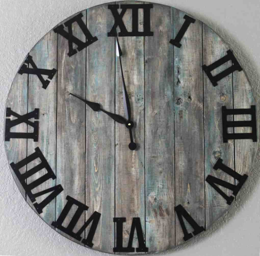 Oversized wall clock. distressed to look like reclaimed wood
