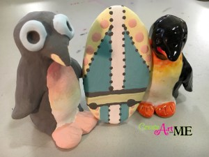 Ceramic Surfer Dude Penguin and surfboard