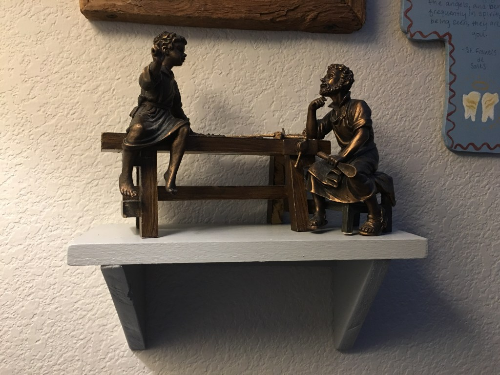 Image: small shelf with Jesus and Joseph statues.