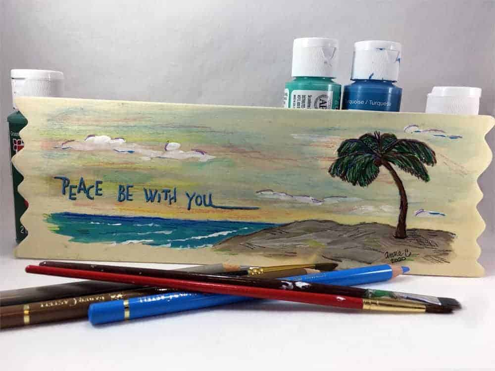 "Image: acrylic and oil pencil painting of a palm tree on the beach, with lettering ""Peach be with you."""