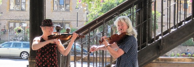 Musicians busking under the old Market House
