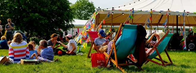 enjoying the sun at hay festival
