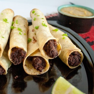 Bean Taquitos with Vegan Nacho Cheese Sauce