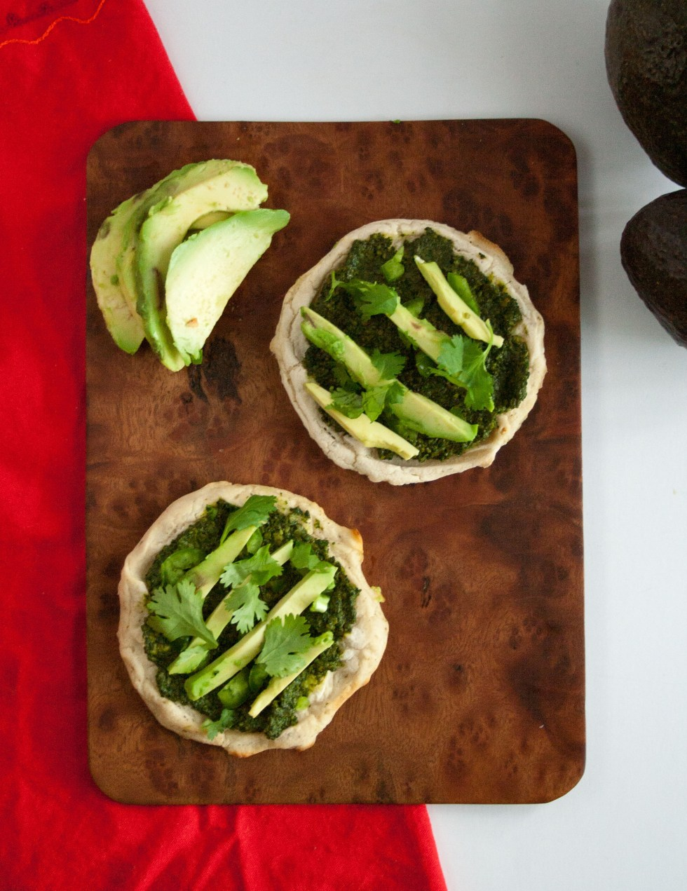 Mini Pizzas with Cilantro Pesto and Avocado - These vegan gluten free pizzas are not only cute, but perfect for a party or as an appetizer.