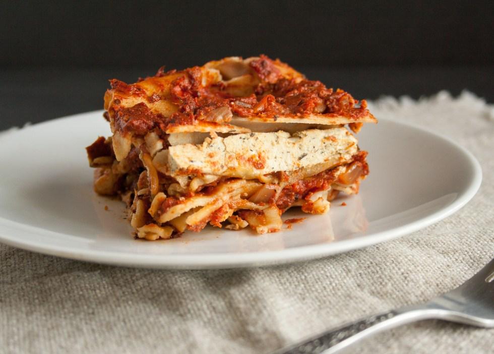 Eggplant Lasagna (vegan, gluten free) - This indulgent vegan lasagna has a homemade tomato sauce with red pepper, homemade tofu ricotta, and grilled eggplant.