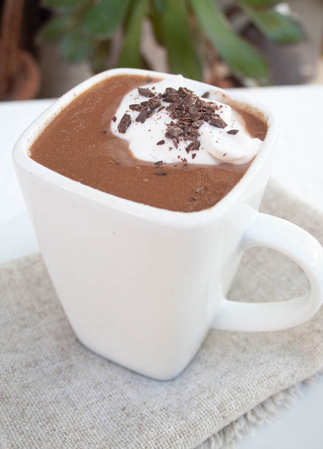 Vegan Hot Chocolate (gluten free) - This sweet rich drink is made with dark chocolate and topped with coconut whipped cream. You won't want store bought after this!