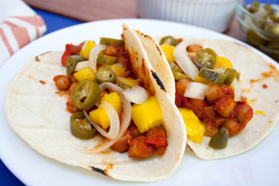 BBQ Chickpea and Mango Tacos with Pickled Peppers and Onions close up of two tacos.
