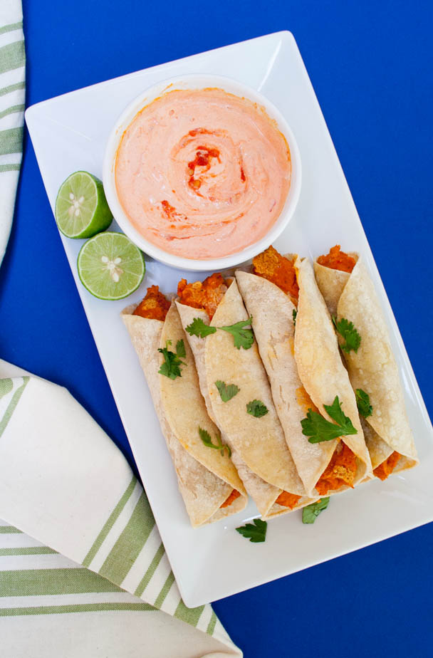 Chickpea and Roasted Red Pepper Taquitos with Harissa Cream (vegan, gluten free) - These healthy baked taquitos make a great appetizer or weeknight meal!