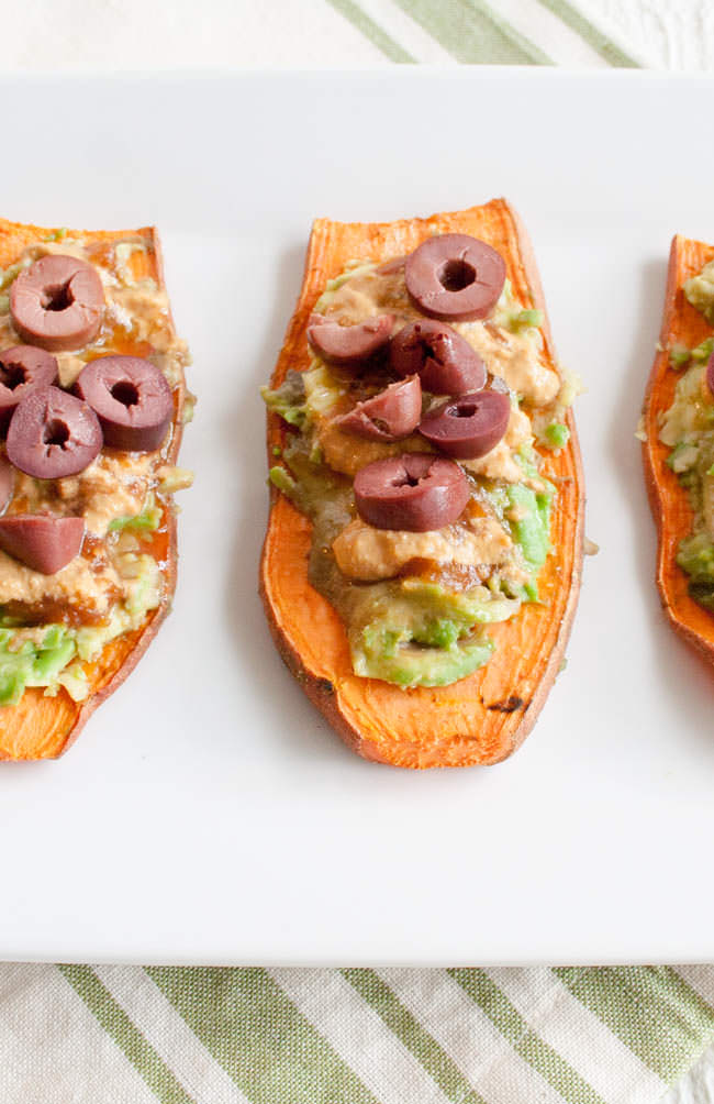 Black Olive and Avocado Sweet Potato Toast with Chipotle Crema close up.