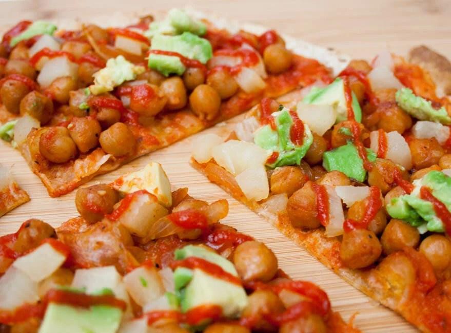 Maple Sriracha Chickpea and Pineapple Tortilla Pizza cut into slices.