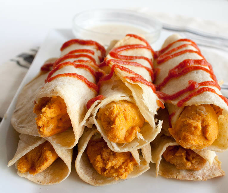Sriracha Hummus Taquitos with Pineapple Mango Dipping Sauce close up.