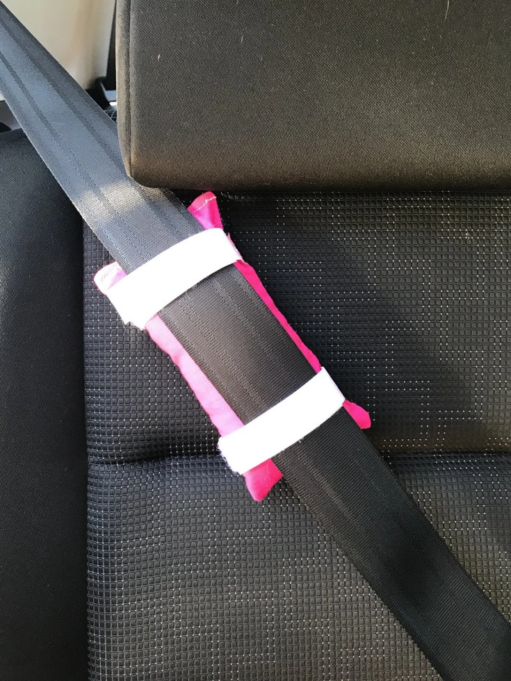 Chemo port pillow attached to a seatbelt.