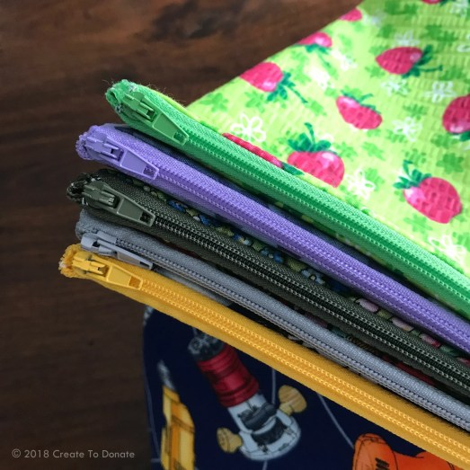 Colorful zippers are used for a simple toiletry bag to help foster children in Los Angelese