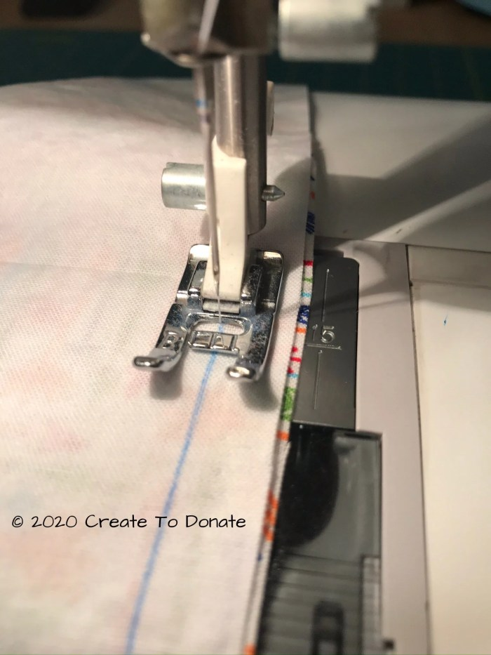 Sew the two pieces of fabric together using the lines as a guide.