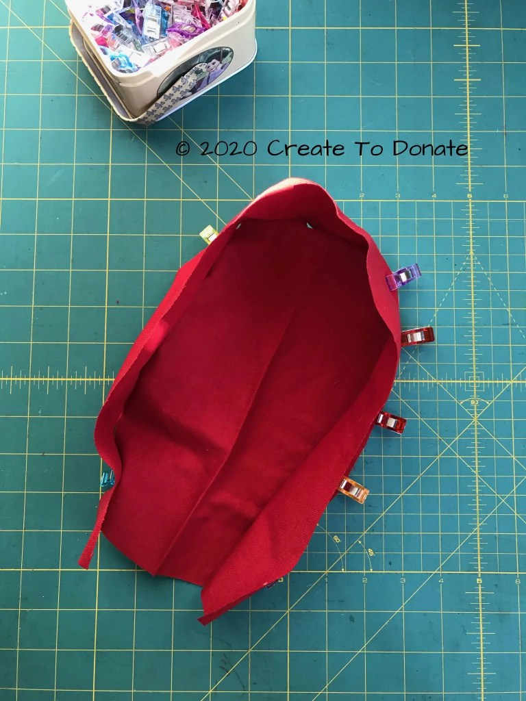 Pieces clipped together for scrub cap sewing