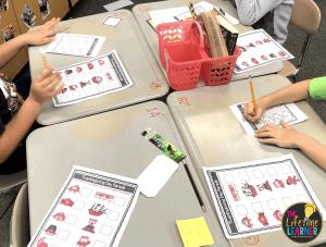 students working in a classroom with papers in front of them