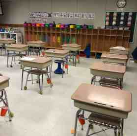 desks with cups for classroom management strategies