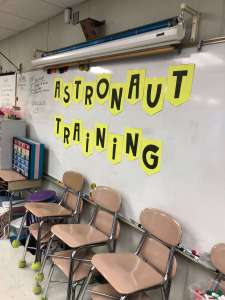 a astronaut training banner on a whiteboard in a classroom