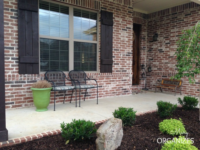Landscape Reveal - Now you can see the porch which makes me want to freshen up the porch decor next