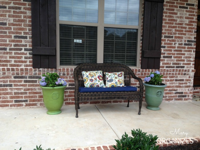 My Front Porch Update - hydrangeas and a wicker bench