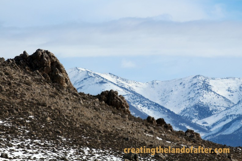 The climate changed as we drove, ancient rock formations framed by snow covered ranges.