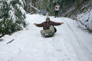 Ryan lives live fully including sledding when the first snow falls
