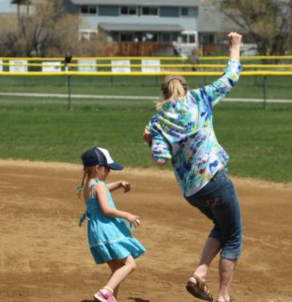 I may be a grandma but I can still run the bases with my granddaughter.