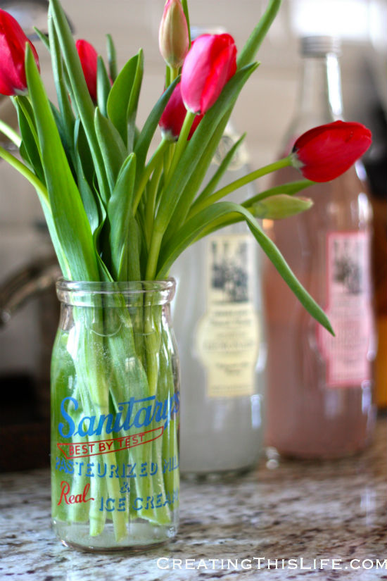tulips in dairy jar