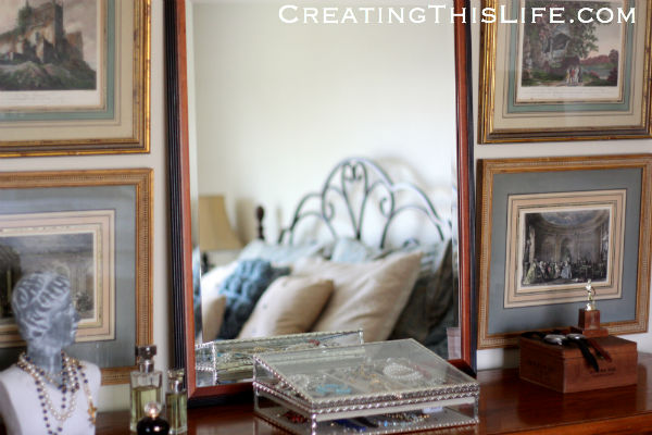 vintage framed prints in master bedroom