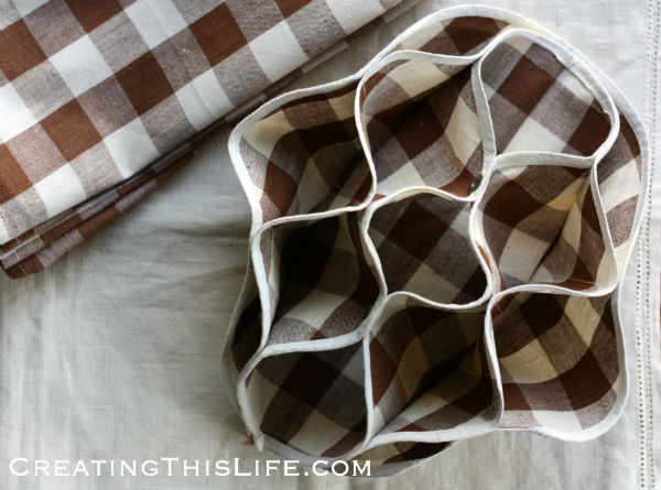 brown and white check roll holder