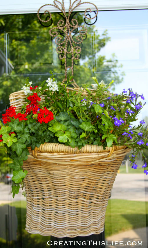 Summer basket with live flowers on front door at CreatingThisLife.com