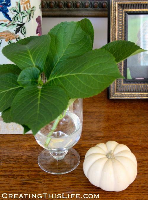 Hydrangea leaf arrangement with fall pumpkin