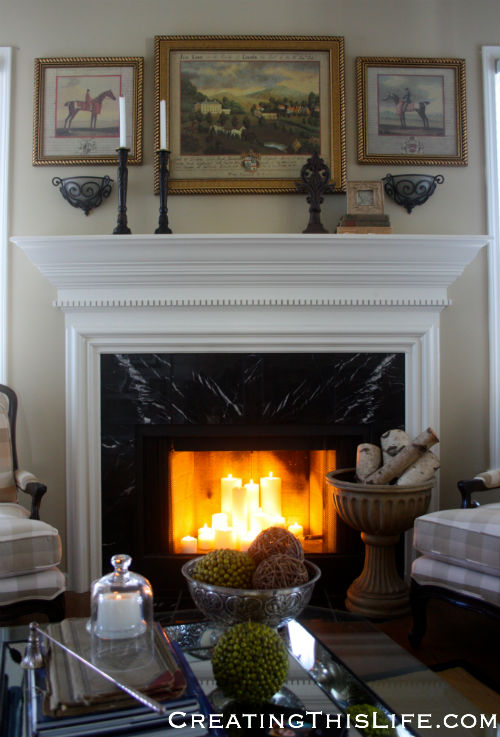 Living room with candles in fireplace