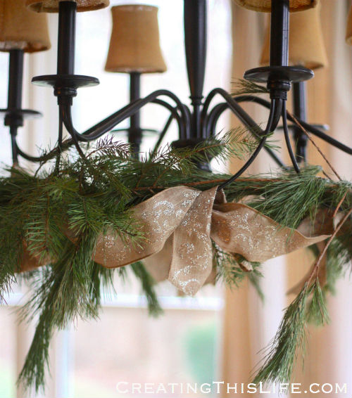 Christmas chandelier greenery and ribbon