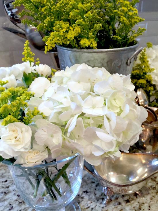 white carnatios and hydrangeas