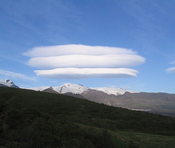 Mundane objects like these lenticular clouds above Skaftafell glacier in Iceland are mistaken as flying saucers due to our cultural conditioning to believe in such things.